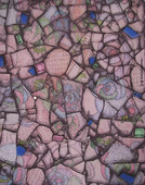 photo of detail of glass mosaic - detail showing patterned drawing under glass - like wall paper in a living room ---- lots of pinks, some blues and greens