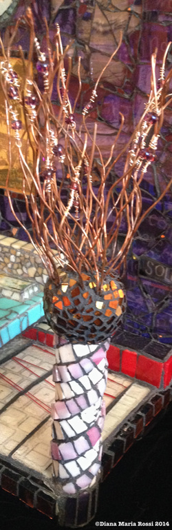 glass mosaic on wood / view of light post with copper wire sprouting out of top