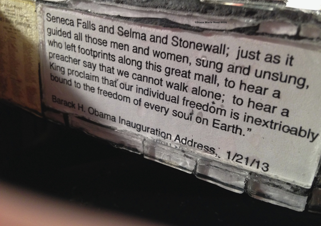 Picture of glass mosaic on wood detail with text under glass Barack Obama's 1/21/13 Inauguration Address