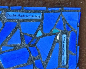 Picture of glass art mosaic on cement board outside detail with text that says: belated thanks to DickGraf/ Diana Maria Rossi ©2002