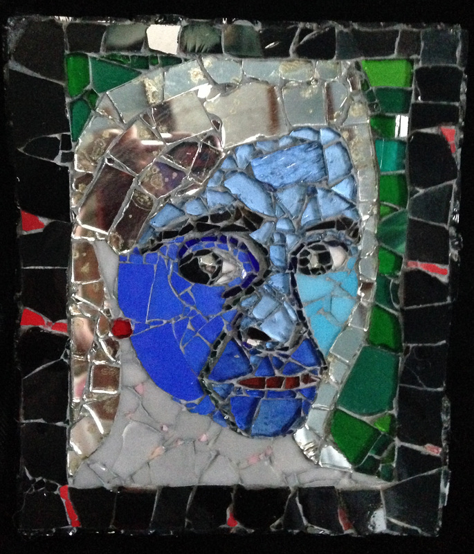 Picture of glass mosaic on wood portrait of Elvira with mirror gray hair and blue face with green background and black border