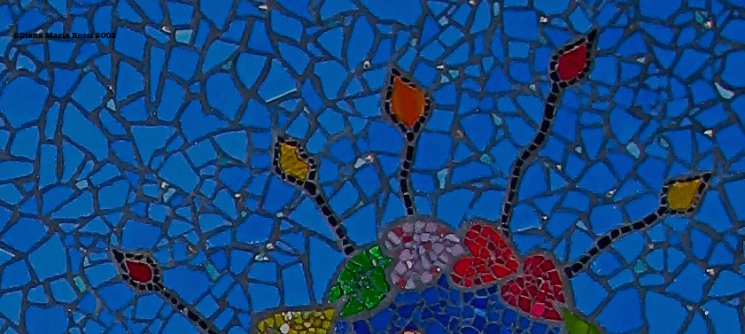 Picture of art glass mosaic Good Fortune in Berkeley on Addison Street detail flame like shapes on muted cobalt blue background
