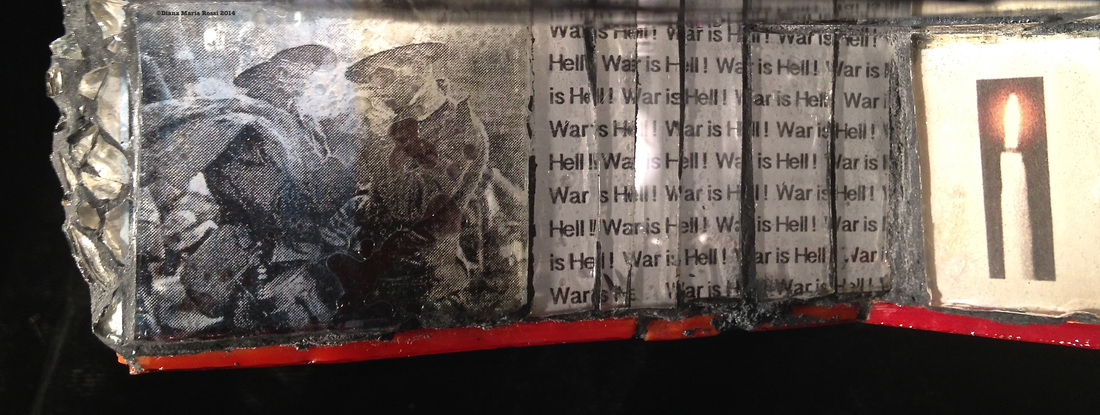 Picture of glass mosaic on wood detail photo under glass two solders during the Christmas Truce of 1914 lighting each other's cigarettes and text that says