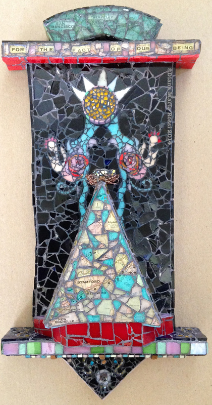 photo of a glass mosaic on wood, triangle shaped, clear glass over a map Diana Maria Rossi  art